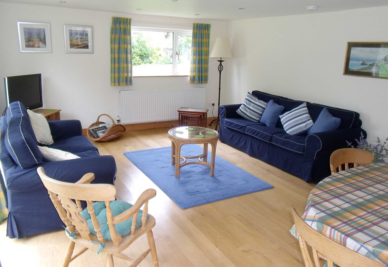 There is comfortable seating in the living area, together with TV/DVD and lovely views of the garden and beyond. 'Wifi' is available and a 'full' sky TV package is also provided.
